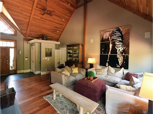 <p><span>31 River Drive South, Bragg Creek, Alta.</span><br>The home is constructed in a timber-frame style, and has cherry floors throughout the lower level.<br>(Photo: Zoocasa) </p>