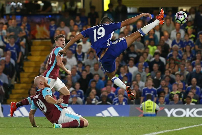 Chelsea's Brazilian-born Spanish striker Diego Costa (R) stretches to reach the ball in the area during the English Premier League football match between Chelsea and West Ham United at Stamford Bridge in London on August 15, 2016