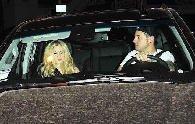 Avril Lavigne and Ryan Cabrera leave Craig's restaurant in West Hollywood on Feb. 6. (Photo: SAF/Splash News)