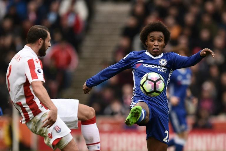 Chelsea's midfielder Willian (R) vies with Stoke City's defender Erik Pieters during the English Premier League football match March 18, 2017
