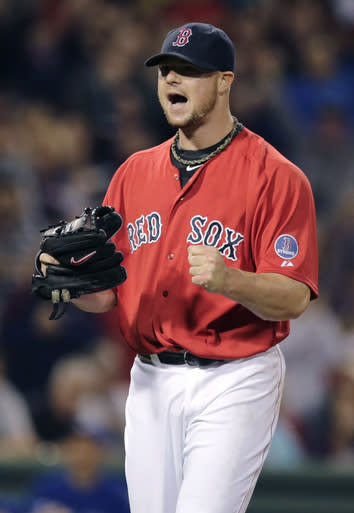 Boston Red Sox starting pitcher Jon Lester pumps his fist and yells after getting Toronto Blue Jays' Jose Reyes to strike out ending the top half of the seventh inning of a baseball game at Fenway Park, Friday, Sept. 20, 2013, in Boston. (AP Photo/Charles Krupa)