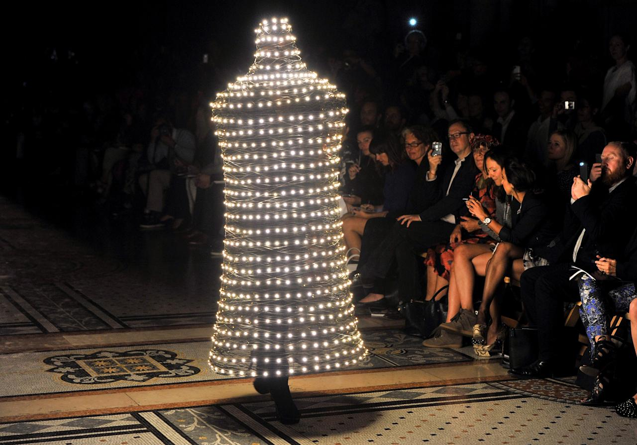 LONDON, ENGLAND - SEPTEMBER 16:  A model showcases designs on the catwalk by Philip Treacy on day 3 of London Fashion Week Spring/Summer 2013, at The Royal Courts Of Justice on September 16, 2012 in London, England.  (Photo by Nick Harvey/WireImage)