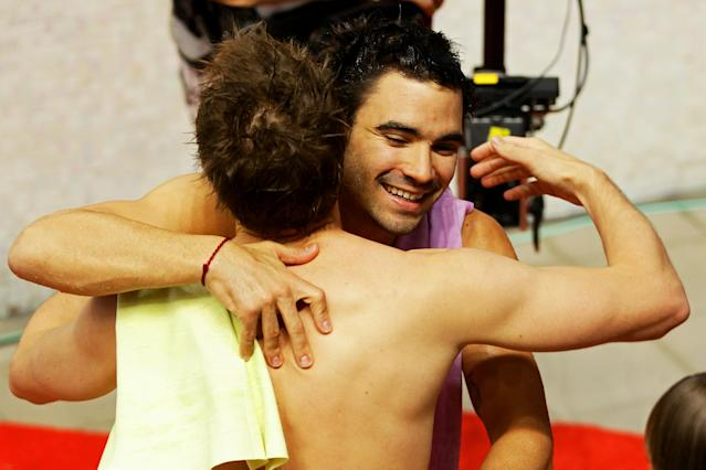 DELHI, INDIA - OCTOBER 11: Alexandre Despatie (R) of Canada celebrates teammate Eric Sehn after winning the gold medal in the Men's 3m Springboard Final at Dr. S.P. Mukherjee Aquatics Complex during day eight of the Delhi 2010 Commonwealth Games on October 11, 2010 in Delhi, India. (Photo by Matt King/Getty Images)