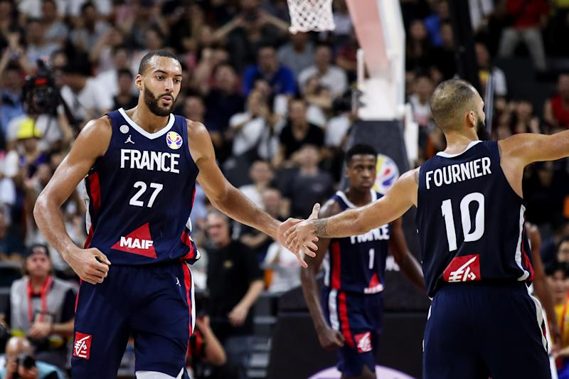 DONGGUAN, CHINA - SEPTEMBER 11: #27 Rudy Gobert of France celebrates a point during the quarter final of 2019 FIBA World Cup between USA and France at Dongguan Basketball Center on September 11, 2019 in Dongguan, China. (Photo by Zhizhao Wu/Getty Images)