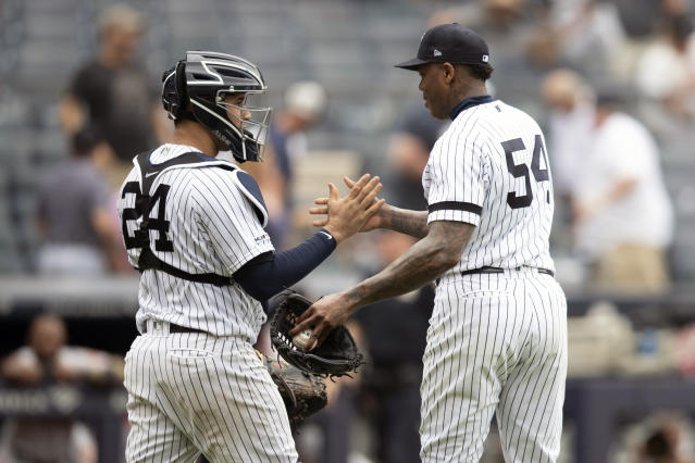 New York Yankees catcher Gary Sanchez (24) and relief pitcher Aroldis Chapman (54) celebrate after Chapman struck Baltimore Orioles' Jonathan Villar out during the ninth inning of a baseball game, Wednesday, Aug. 14, 2019, in New York. (AP Photo/Mary Altaffer)