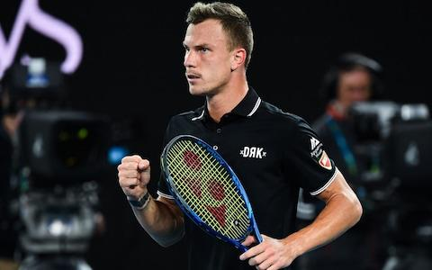 ungary's Marton Fucsovics reacts after a point against Switzerland's Roger Federer during their men's singles match on day seven of the Australian Open tennis tournament in Melbourne on January 26, 2020