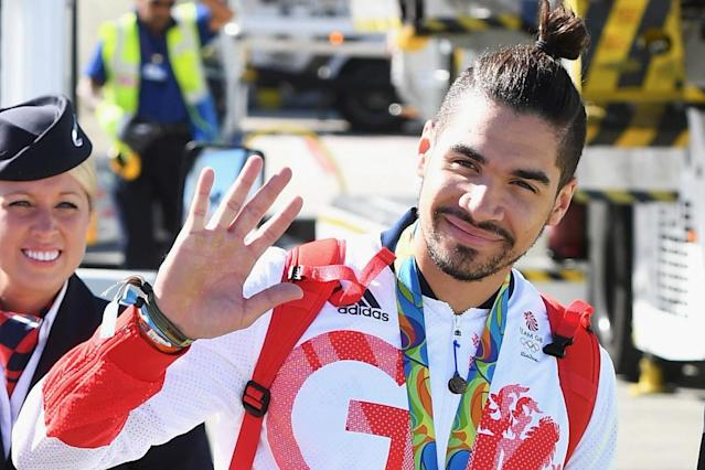 Olympic star Louis Smith live tweets race row after Virgin Trains waiter 'demands he and another black passenger show First Class tickets'