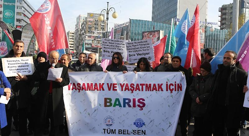 "Members of Turkish unions hold a banner reading ""Peace"" during a protest in Ankara calling for an end to violence between security forces and Kurdish militants in southeast Turkey on December 25, 2015 (AFP Photo/Adem Altan)"