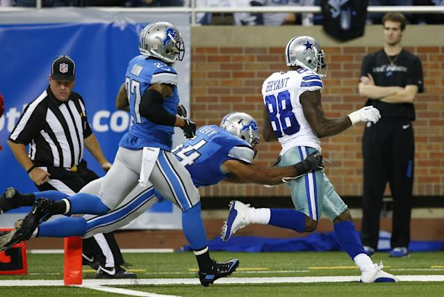 Dallas Cowboys wide receiver Dez Bryant (88) scores on a 50-yard touchdown reception as Detroit Lions outside linebacker DeAndre Levy (54) defends in the fourth quarter of an NFL football game in Detroit, Sunday, Oct. 27, 2013. (AP Photo/Rick Osentoski)