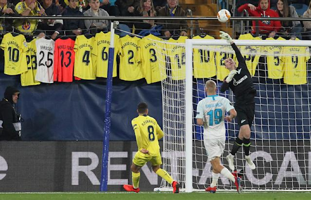 Zenit's goalkeeper Andrei Lunev tips the ball over the bar during a Europa League round of 16, 2nd leg soccer match between Villarreal and Zenit St.Petersburg at the Ceramica stadium in Villarreal, Spain, Thursday March 14, 2019. (AP Photo/Alberto Saiz)