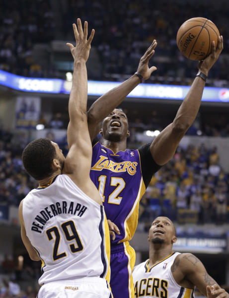 Los Angeles Lakers center Dwight Howard, right, hits a shot over Indiana Pacers forward Jeff Pendergraph in the first half of an NBA basketball game in Indianapolis, Friday, March 15, 2013. (AP Photo/Michael Conroy)