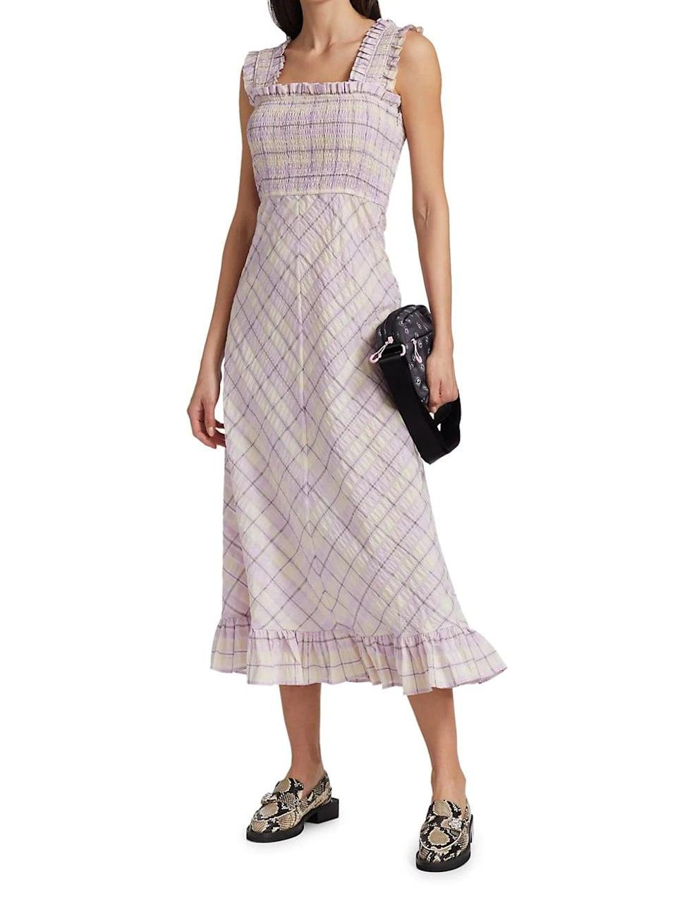 <p>This <span>Ganni Seersucker Check Smocked Midi Dress</span> ($285) is as effortless and cool as a summer dress will get.</p>
