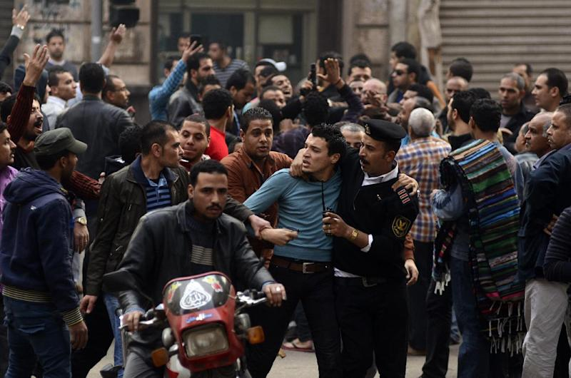 FILE - In this Saturday, Jan. 25, 2014 file photo, a supporter of Egypt's ousted President Mohammed Morsi is detained by police during clashes with security forces in downtown Cairo, Egypt. On Tuesday, Feb. 11, 2014, the third anniversary of the day Hosni Mubarak stepped down as Egypt's president after an 18-day uprising, the government blocked access to Tahrir Square and letters emerged from activists reporting that they have been beaten and subjected to other abuses by police after being arrested in a string of protests in late January. (AP Photo/Ahmed Gamil, File)