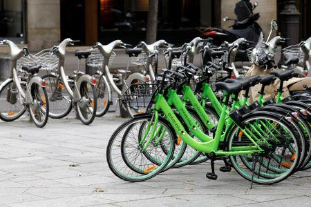 Several 'Gobee.bike' bicycles, a city's bike-sharing service, are left on a road side in Paris, France