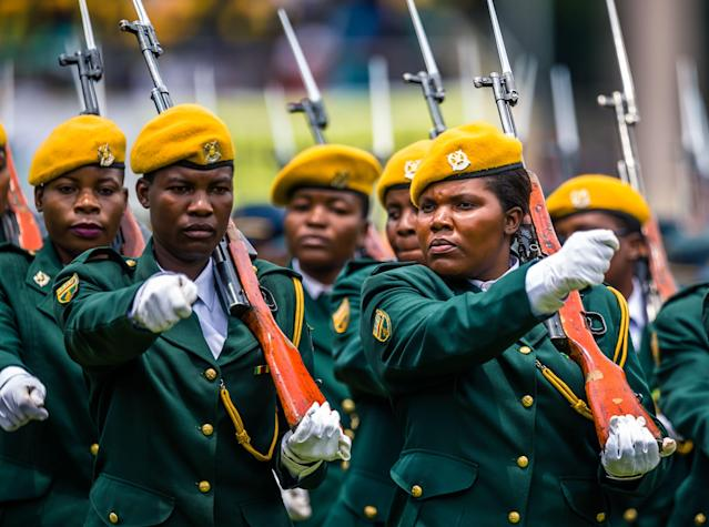 <p>Soldiers march as Zimbabwe's new interim President reviews the honour guard for the first time after being sworn-in at the National Sports Stadium in Harare, on Nov. 24 2017. (Photo: Jekesai Njikizana/AFP/Getty Images) </p>