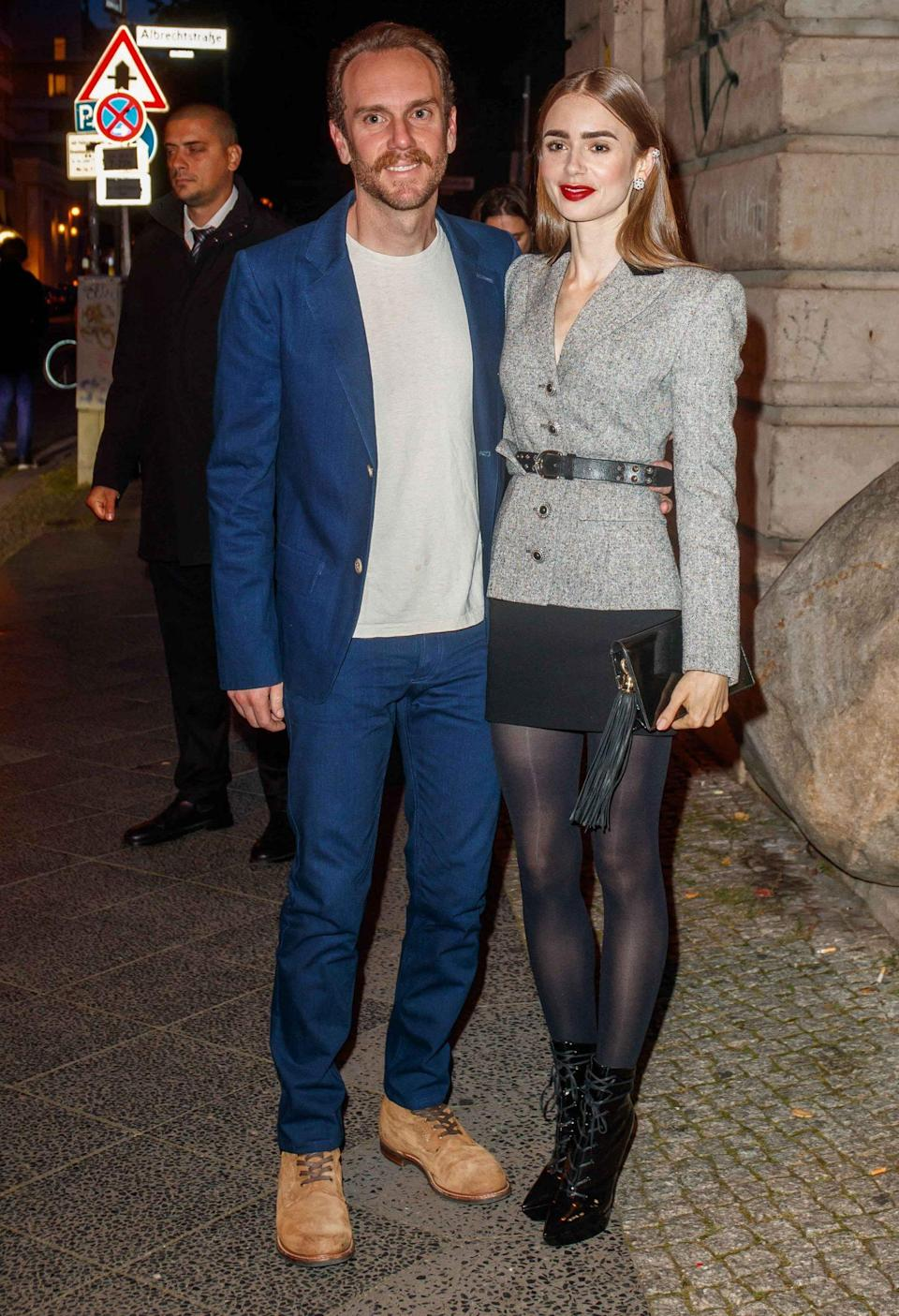 <p> Lily Collins and husband Charlie McDowell get all dressed up for the Clash de Cartier event in Berlin on Sept. 21.</p>