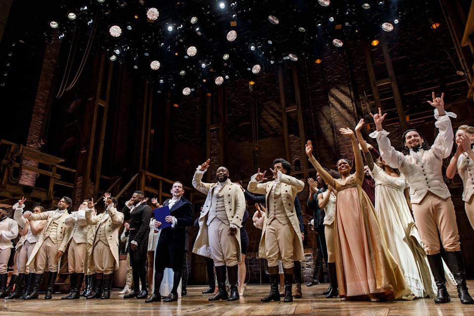 """Miguel Cervantes and the cast of """"Hamilton"""" take a curtain call after the final production of the show in Chicago on Jan. 5, 2020, at the CIBC Theatre. (Brian Cassella/Chicago Tribune/Tribune News Service via Getty Images)"""