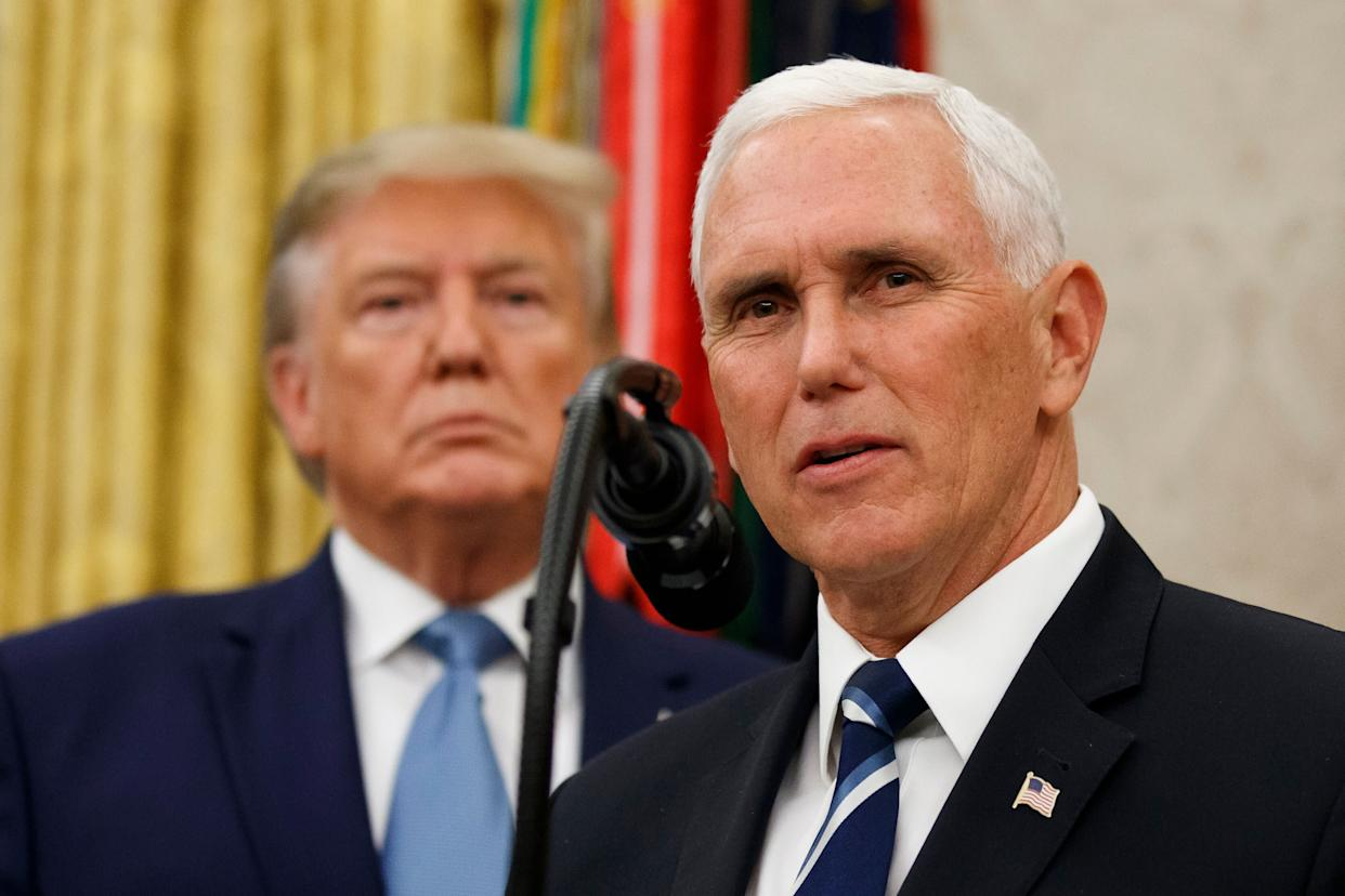 Vice President Mike Pence, right, speaks with President Donald Trump behind him, during a ceremony to present the Presidential Medal of Freedom to former Attorney General Edwin Meese on Oct. 8. (Photo: Alex Brandon/ASSOCIATED PRESS)