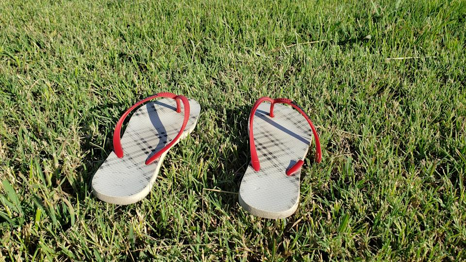 Pair of thong sandals on a lawn