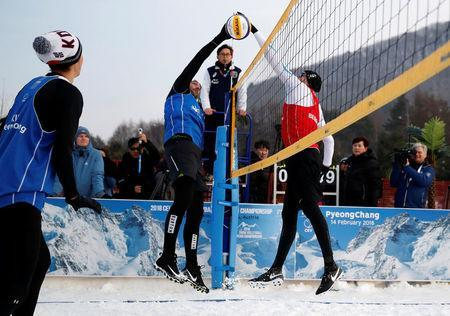 Pyeongchang 2018 Winter Olympics - Pyeongchang - South Korea – February 14, 2018. Nikolas Berger of Austria and Giba Godoy of Brazil in action during an event promoting the Snow Volleyball hosted by the International Volleyball Federation (FIVB) and European Volleyball Confederation (CEV). REUTERS/Kim Hong-Ji