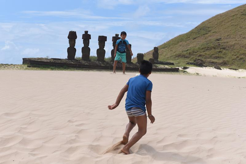 EASTER ISLAND, CHILE - 2019/09/22: Boys playing with a ball at the Anakena beach. Easter Island, also known as Rapa Nui, is an island in the Pacific Ocean belonging to Chile. The Island is famous for its moais and is a World Heritage Site by UNESCO with much of its territory within the Rapa Nui National Park. Its population is around 6,000 inhabitants. (Photo by John Milner/SOPA Images/LightRocket via Getty Images)