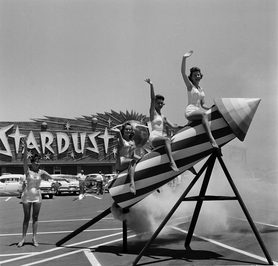 <p> Women sit and pose on a rocket outside the Stardust Resort and Casino in 1958. When the hotel opened, it had the largest casino and swimming pool in Nevada. </p>