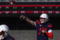 Arizona quarterback Grant Gunnell (17) throws downfield against Southern California in the first half during an NCAA college football game, Saturday, Nov. 14, 2020, in Tucson, Ariz. (AP Photo/Rick Scuteri)