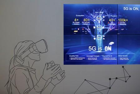 FILE PHOTO: A screen is seen in a showroom of 5G technology in Huawei's headquarters in Shenzhen