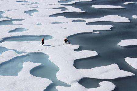 The crew of the U.S. Coast Guard Cutter Healy, in the midst of their ICESCAPE mission, retrieves supplies in the Arctic Ocean in this July 12, 2011 NASA handout photo. Kathryn Hansen/NASA via REUTERS/Files