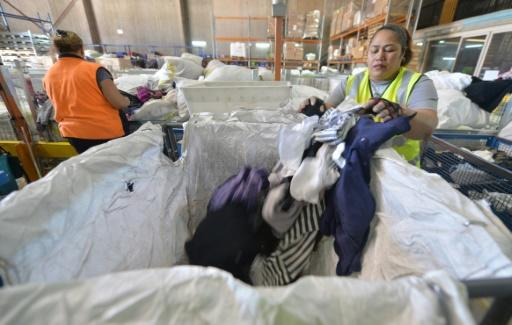 Workers sort clothing at the St Vincent de Paul Society recycling charity in Sydney