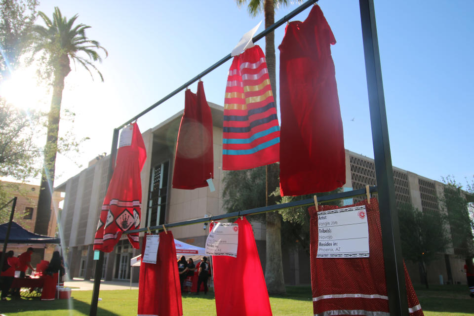 Red skirts are on display at the Arizona State Capitol in Phoenix, Wednesday, May 5, 2021, to raise awareness for missing and murdered Indigenous women and girls. Phoenix Indian Center Executive Director Patricia Hibbeler said the skirts are a huge part of the lives of Native American women and girls. These skirts were created by volunteers at the center in the last few weeks. (AP Photo/Cheyanne Mumphrey)