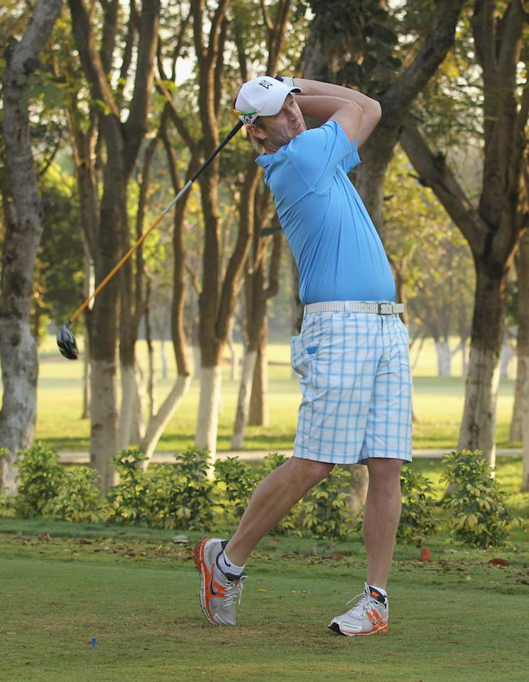 BANGALORE, INDIA - MARCH 8:  Cameron White of Australia tees off during a game of golf at Karnataka Golf Course on March 8, 2011 in Bangalore, India. (Photo by Hamish Blair/Getty Images)