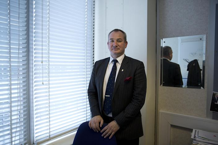 In this photo taken on Wednesday, Sept. 18, 2013, DCI Mick Neville who oversees the Metropolitan Police Circulation Unit poses for photographs in his office at the force's New Scotland Yard headquarters in London. The study of facial recognition is in its infancy. But since 2011, about 200 London police officers have been recruited to an elite squad of super recognizers. Officials say they have tripled the number of criminal suspects identified from surveillance photos or on the street each week, and even helped prevent some crimes like muggings, drug deals or assaults. (AP Photo/Matt Dunham)