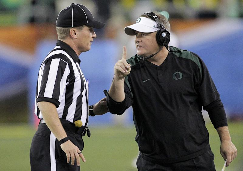 Oregon head coach Chip Kelly, right, signals a 1-point safety to the referee during the second half of the Fiesta Bowl NCAA college football game against Kansas State, Thursday, Jan. 3, 2013, in Glendale, Ariz. (AP Photo/Matt York)