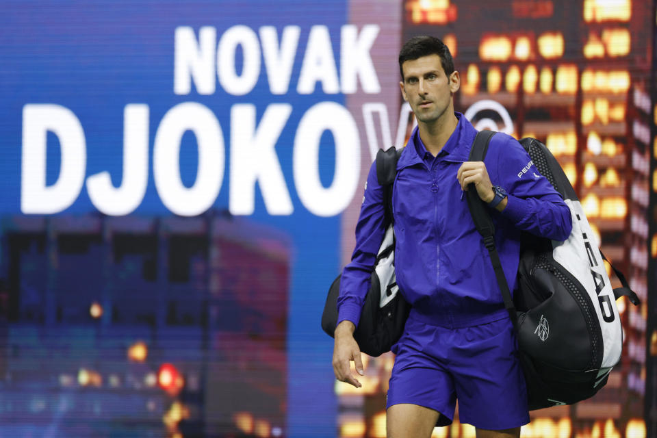 Novak Djokovic (pictured) walks out onto the court to warm-up against Holger Rune at the US Open.
