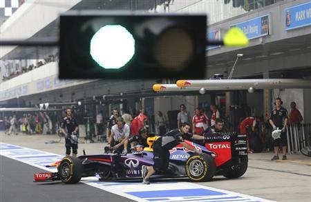 Red Bull Formula One driver Sebastian Vettel of Germany has his car pushed back into his team garage during the qualifying session of the Indian F1 Grand Prix at the Buddh International Circuit in Greater Noida, on the outskirts of New Delhi, October 26, 2013. REUTERS/Aijaz Rahi/Pool