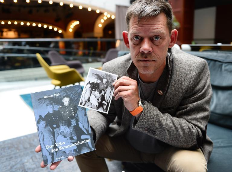 "Rainer Hoess -- the grandson of Rudolf Hoess, the Nazi commandant of the Auschwitz concentration camp -- displays his book ""The Legacy of the Commandant"" during an interview in Stockholm, on April 30, 2014"