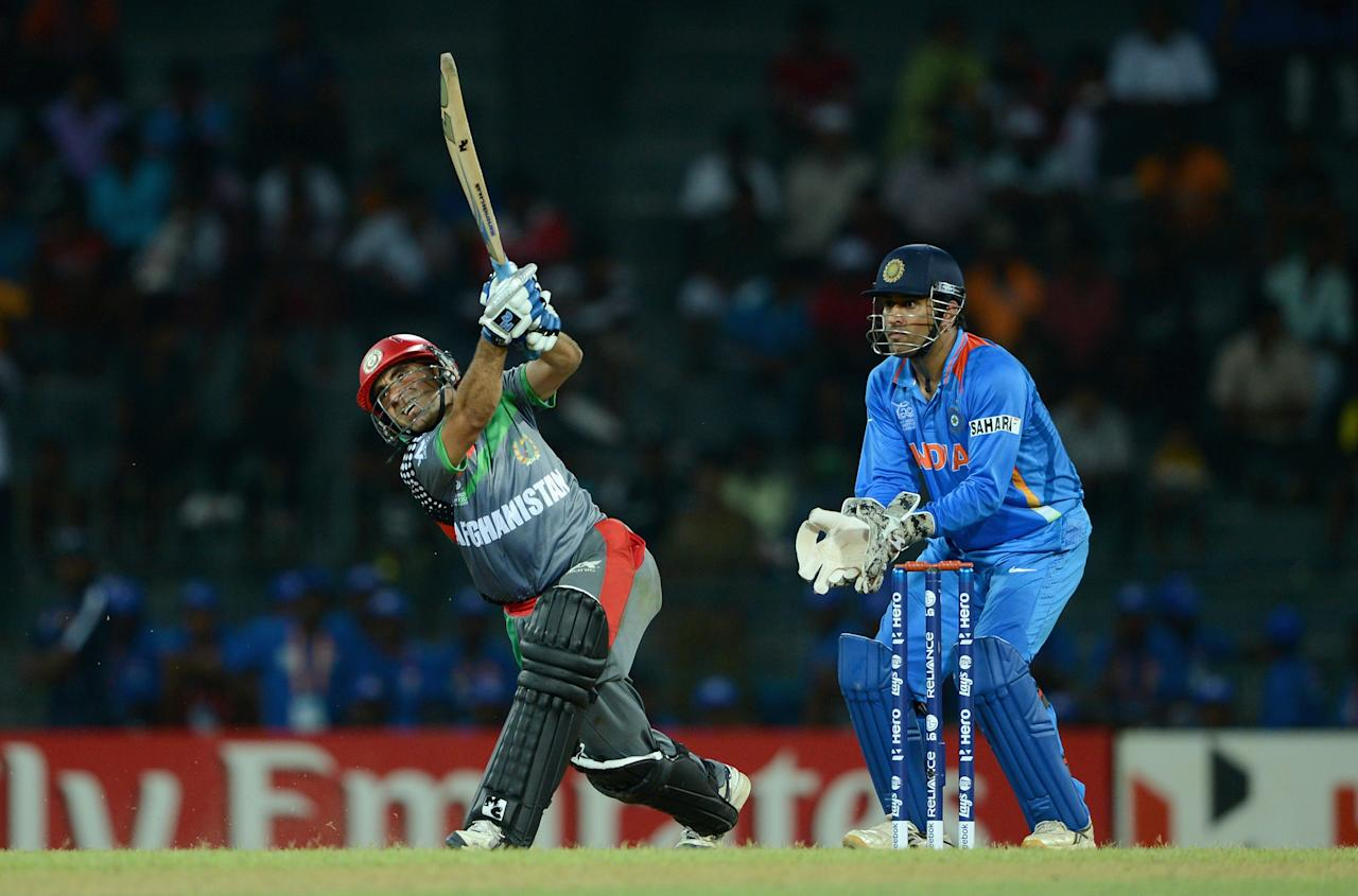 COLOMBO, SRI LANKA - SEPTEMBER 19:  Karim Sadiq of Afghanistan bats watched by India wicketkeeper MS Dhoni during the  ICC World Twenty20 2012: Group A match between India and Afghanistan at R. Premadasa Stadium on September 19, 2012 in Colombo, Sri Lanka.  (Photo by Gareth Copley/Getty Images,)