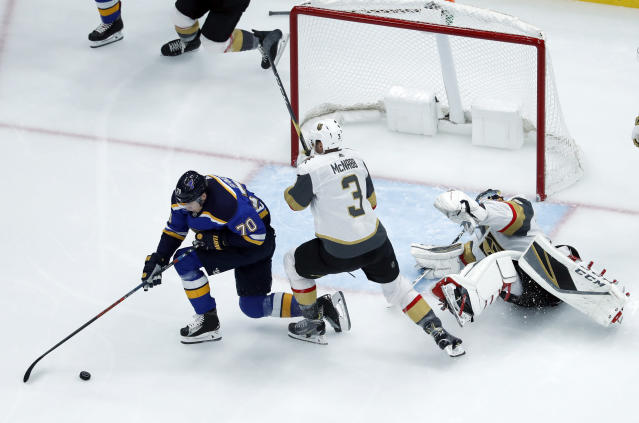 St. Louis Blues' Oskar Sundqvist (70), of Sweden, spins around to score past Vegas Golden Knights goaltender Marc-Andre Fleury, right, and Brayden McNabb (3) during the first period of an NHL hockey game Thursday, Nov. 1, 2018, in St. Louis. (AP Photo/Jeff Roberson)