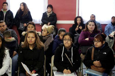 FILE PHOTO: Migrants attend a workshop for legal advice held by the Familia Latina Unida and Centro Sin Fronteras in south Chicago