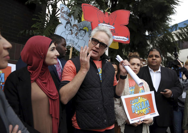 <p>Actor Bradley Whitford speaks to demonstrators, urging the Democrats to protect the Deferred Action for Childhood Arrivals (DACA) program, during a rally outside the office of California Democratic Sen. Dianne Feinstein in Los Angeles, Jan. 3, 2018. (Photo: Reed Saxon/AP) </p>