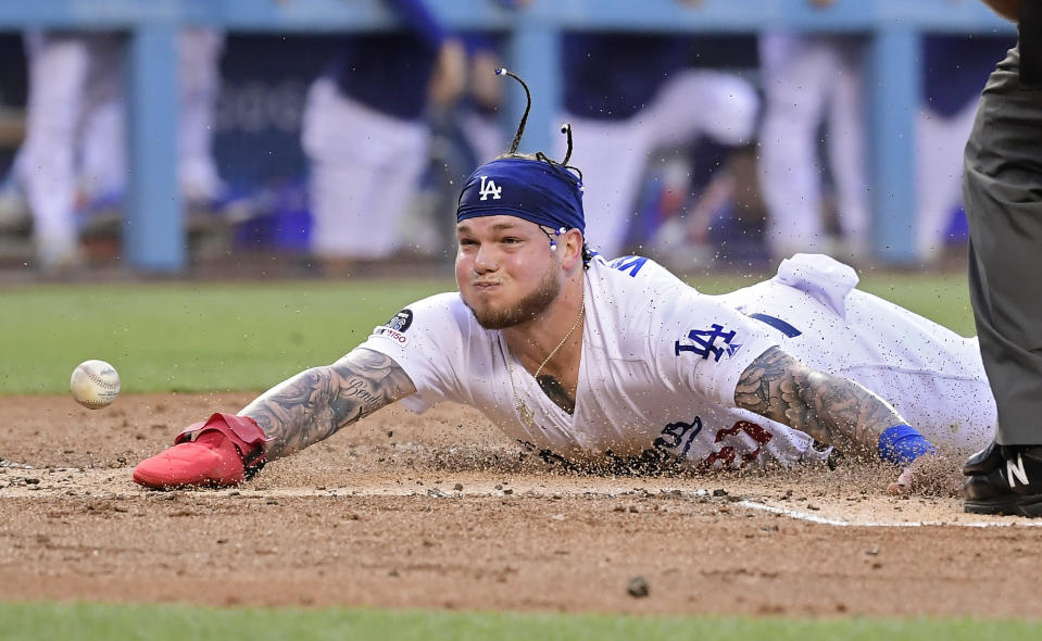Los Angeles Dodgers' Alex Verdugo scores on a double by Justin Turner after San Francisco Giants catcher Buster Posey missed the throw during the first inning of a baseball game Tuesday, June 18, 2019, in Los Angeles. (AP Photo/Mark J. Terrill)