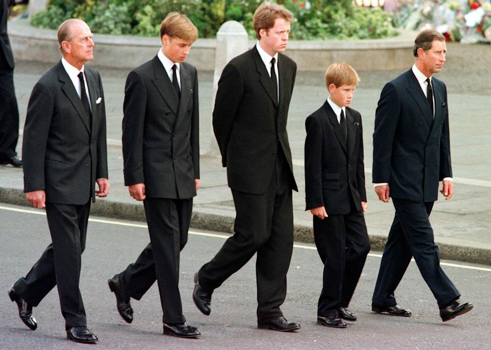 (L to R) The Duke of Edinburgh, Prince William, Earl Spencer, Prince Harry and Prince Charles walk outside Westminster Abbey during the funeral service for Diana, Princess of Wales, 06 September. Hundreds of thousands of mourners lined the streets of Central London to watch the funeral procession. The Princess died last week in a car crash in Paris. (Photo credit should read JEFF J. MITCHELL/AFP via Getty Images)