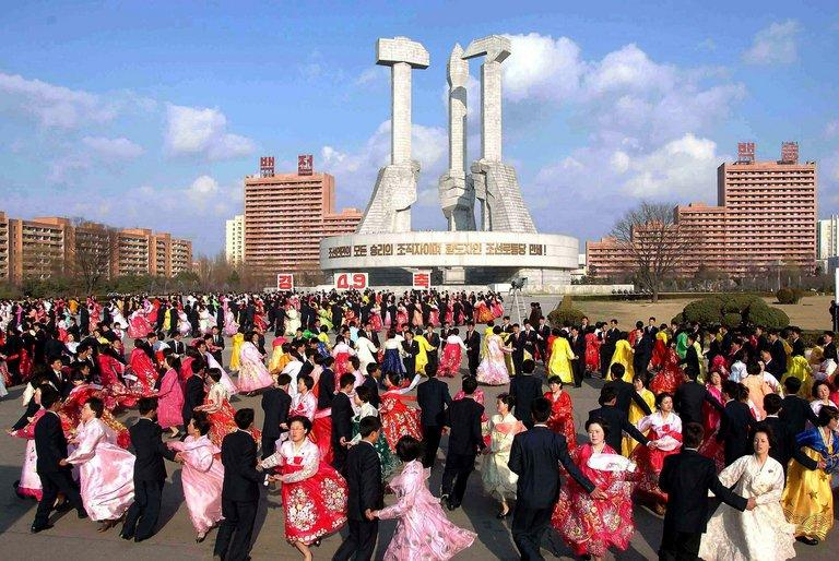 "Young people and students dance in Pyongyang to celebrate the 20th anniversary of late leader Kim Jong Il's election as chairman of North Korea's National Defence Commission, in a photo released by North Korea's official Korean Central News Agency (KCNA) on April 9, 2013. South Korean and US forces raised their alert status to ""vital threat"" Wednesday before an expected North Korean missile test"