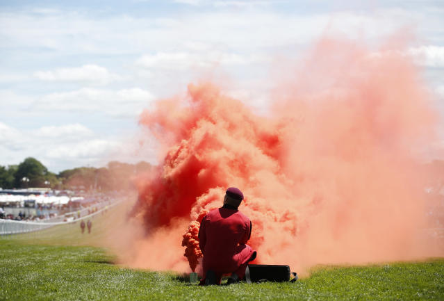 Britain Horse Racing - Derby Festival - Epsom Racecourse - June 3, 2017 General view of a flare for the Red Devils parachute display team during the Derby Festival Action Images via Reuters / Matthew Childs Livepic EDITORIAL USE ONLY.