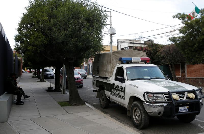 A police patrol vehicle is seen at the entrance of Mexico's embassy in La Paz