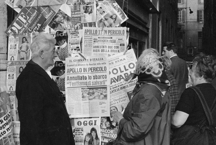 FILE - In this April 14, 1970 file photo, people in Rome look at newspapers headlining the trouble that developed aboard the U.S.'s Apollo 13 mission which led to the cancellation of the attempt to land on the moon. (AP Photo)