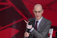 FILE - In this Oct. 4, 2020, file photo, NBA Commissioner Adam Silver does an interview before Game 3 of basketball's NBA Finals in Lake Buena Vista, Fla. Sports got taken down a notch in 2020. The lights went out in mid-March, soon after Silver flipped a circuit-breaker on the season. (AP Photo/Mark J. Terrill, File)