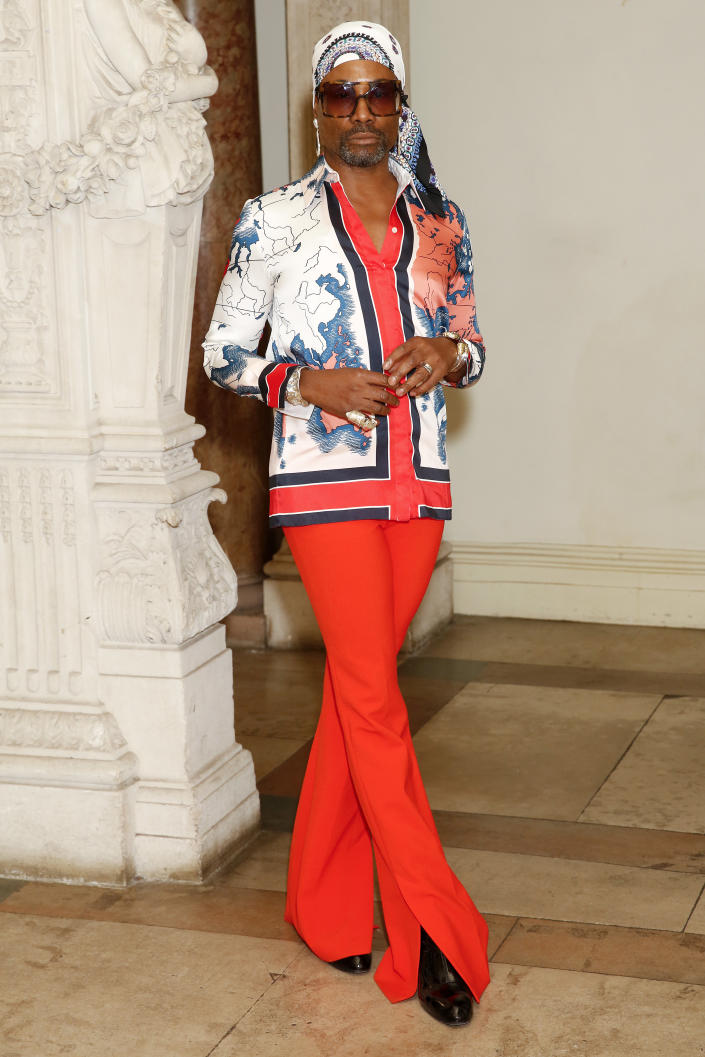 Billy Porter arrived at the Victoria Beckham show wearing a Japanese-inspired shirt with matching red trousers and a bandana [Photo: Getty Images]