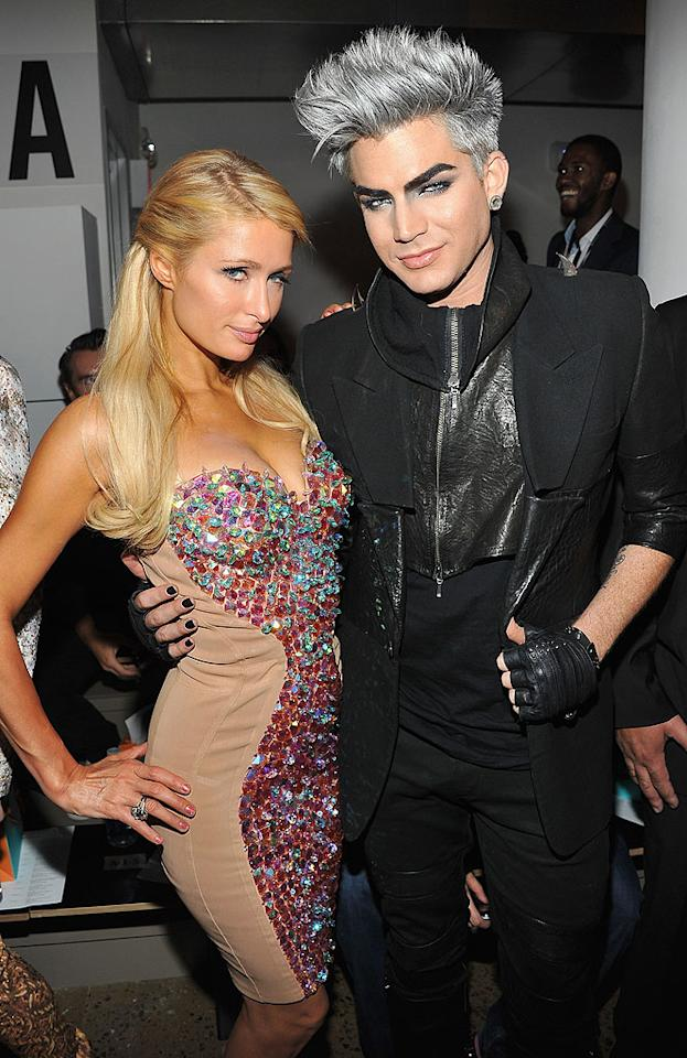 "Paris Hilton and Adam Lambert's garish garb fit right in at The Blonds presentation. The fashion house, whose theme for this year's show was ""Psycho Beach Party,"" is known for their fun-loving frocks. (9/11/12)"
